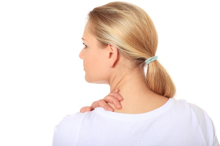 neck girl: Attractive blonde woman suffering from neck pain. All on white background.  Stock Photo