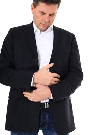 Attractive middle-aged man suffering from stomachache. All on white background.  Stock Photo - 8824940