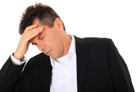 male headache: Attractive middle-aged man suffering from headache. All on white background.  Stock Photo
