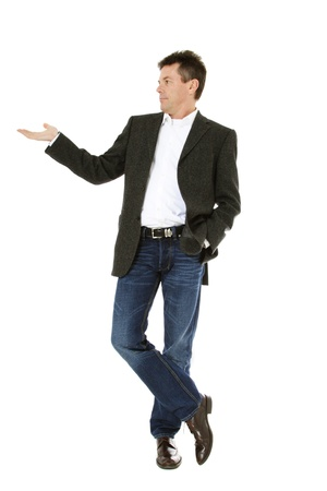 Attractive middle-aged man pointing to the side. All on white background.  Stock Photo - 8824707