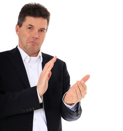 aplaudiendo: Hombre de mediana edad impresionado aplaudiendo. Todo sobre fondo blanco.  Foto de archivo