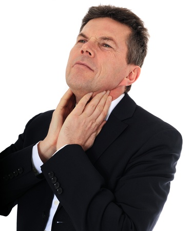 Attractive middle-aged man suffering from sore throat. All on white background.  photo