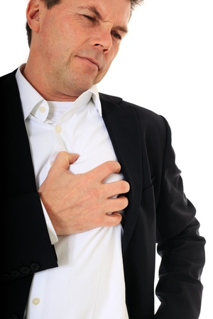 heart healthy: Attractive middle-aged man suffering from heart attack. All on white background.  Stock Photo
