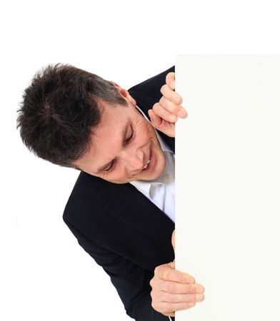 Attractive middle-aged man standing behind a white board. All on white background. Stock Photo - 8824858
