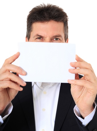 Attractive middle-aged man holding blank white card. All on white background. Stock Photo - 8824930