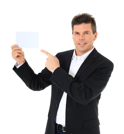 Attractive middle-aged man pointing at blank white card. All on white background. Stock Photo - 8824864