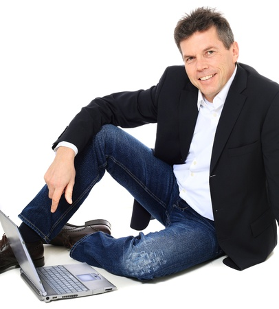 european community: Attractive middle-aged man using notebook computer. All on white background.