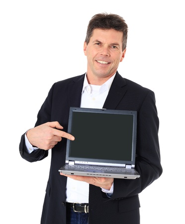 Attractive middle-aged man pointing on notebook computer. All on white background.  Stock Photo - 8824882