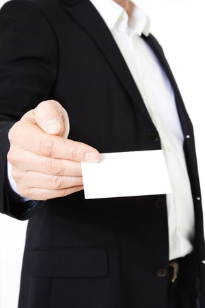 business consultant: Attractive middle-aged man giving business card. All on white background.  Stock Photo