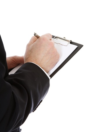 Middle-aged man writing on clipboard. All on white background.  photo