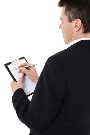 stocktaking: Attractive middle-aged man writing on clipboard. All on white background.  Stock Photo