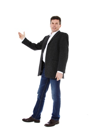 Attractive middle-aged man pointing to the side. All on white background. Stock Photo - 8824703