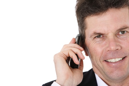 Attractive middle-aged man making a phone call. All on white background.  Stock Photo - 8824804