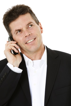 Attractive middle-aged man making a phone call. All on white background.  Stock Photo - 8824812