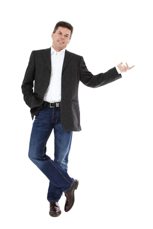 Attractive middle-aged man pointing to the side. All on white background. Stock Photo - 8824711