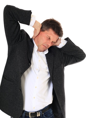 Attractive middle-aged man suffering from tinnitus. All on white background.  photo
