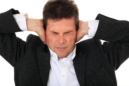Attractive middle-aged man suffering from headache. All on white background.  photo