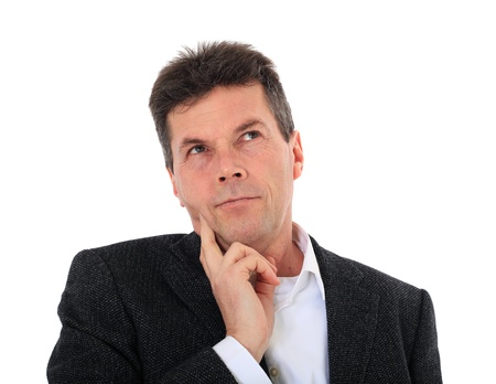 Attractive middle-aged man deliberates a decision. All on white background.  photo