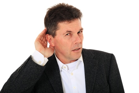 Attractive middle-aged man cannot hear anything. All on white background.  photo