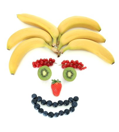 Human face out of various fruits photo