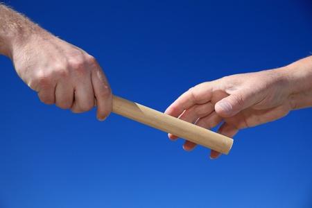 Handing someone a baton.