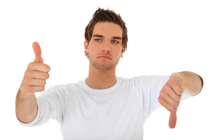 good or bad: Attractive young man showing thumbs up and thumbs down. All on white background.