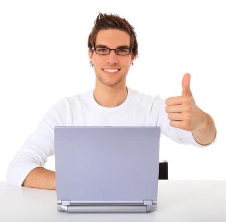Smiling young guy using notebook computer. All on white background.  photo