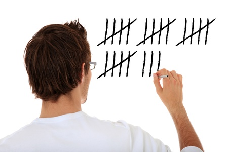 Back view of an attractive young man counting. All on white background. Stock Photo - 9779892