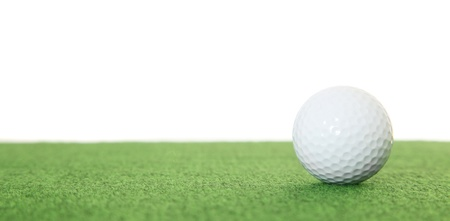 Golf ball lying on the green. All isolated on white background. photo