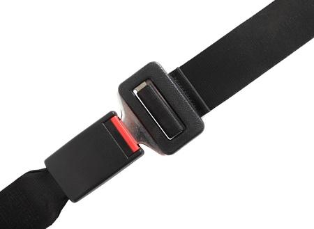 cinturon seguridad: Sujetada del cintur�n de seguridad. Todo sobre la imagen de fondo blanco.  Foto de archivo