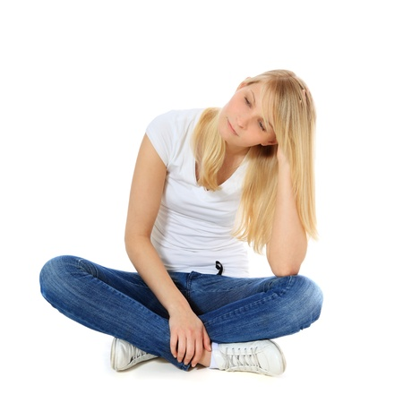 Frustrated teenage girl. All on white background.  Stock Photo - 9780222