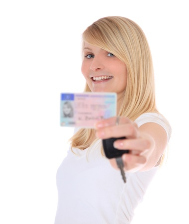 Young woman presenting her driver´s licence. All on white background.