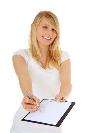 Attractive teenage girl doing a survey. All on white background.  免版税图像