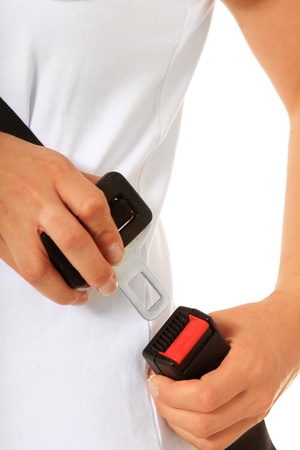 fastens: A person fastens the seat belt. All on white background