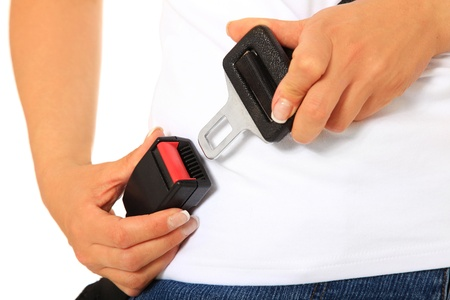 fastens: A person fastens the seat belt. All on white background.