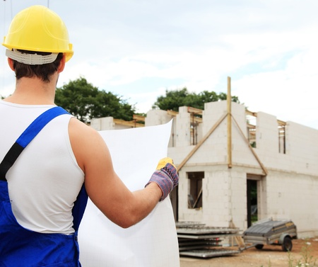 Manual worker on construction site during building inspection. Stock Photo - 9781143