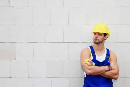 Manual worker on construction site. Stock Photo - 9781107