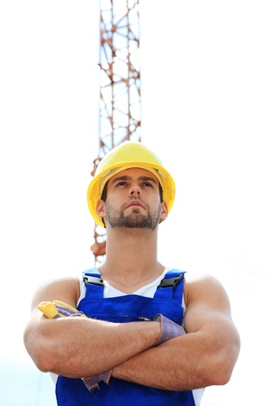 Manual worker on construction site. Stock Photo - 9852890