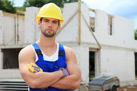 Manual worker on construction site. Stock Photo - 9781333