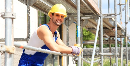 Manual worker on construction site. Stock Photo - 9852894