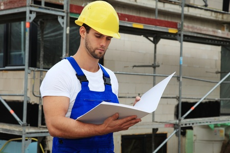 Manual worker on construction site during building inspection.  Stock Photo - 9781108
