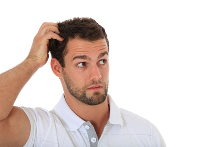 baffled: Clueless young guy. All on white background.  Stock Photo