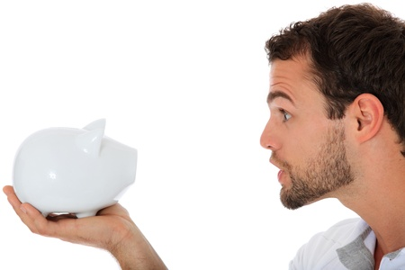 Young guy yells at his piggy bank. All on white background. Stock Photo - 9780943