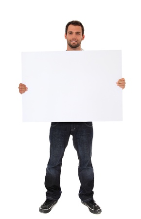 Attractive young man holding blank white sign. All on white background. Stock Photo - 9780637
