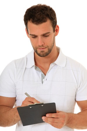 Portrait of a young man writing on clipboard. All on white background.