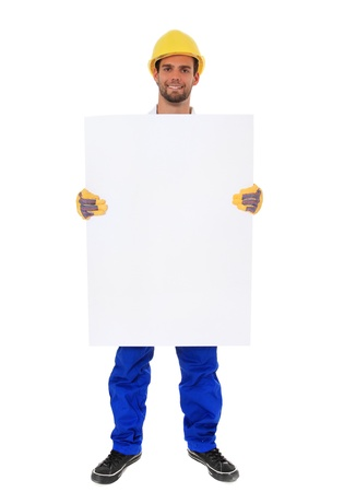 contrema�tre: Sur toute la longueur tir� d'un travailleur de la construction qui tient une pancarte blanche. Tout sur fond blanc. Banque d'images