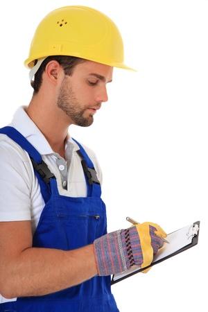 contrema�tre: Travailleur de la construction par �crit sur le presse-papiers. Tout sur fond blanc.  Banque d'images