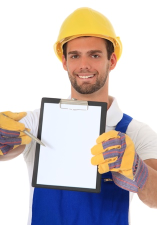 Construction worker pointing on clipboard . All on white background.  photo
