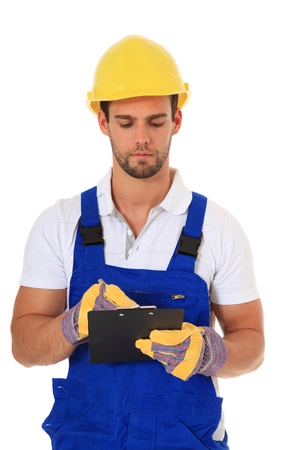 Construction worker writing on clipboard. All on white background.  photo