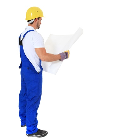 overseer: Full length shot of a construction worker studying construction plan. All on white background.  Stock Photo